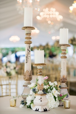 three marble candlesticks of varying heights at wedding reception