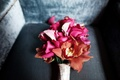 Fuchsia calla lily and orchid flowers on couch