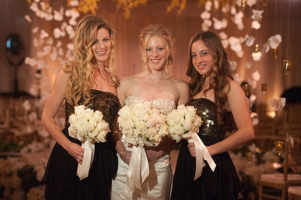 Bride with two bridesmaids with curled hair and sparkle dresses