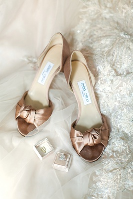 satin rose gold champagne jimmy choo bridal heels with knot at the toe