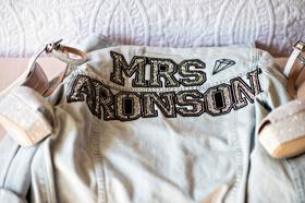 wedding accessories for bride on wedding day glitter platform heels and custom jean jacket mrs