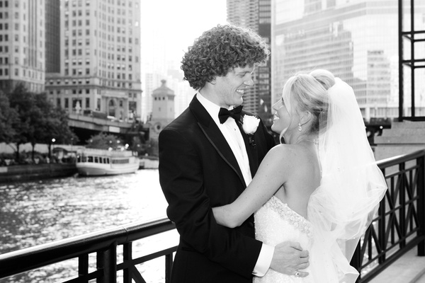 black and white photo of newlyweds gazing into each other's eyes