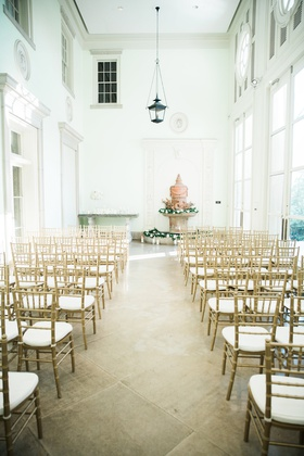 gold chiavari chairs, indoor wedding ceremony with fountain