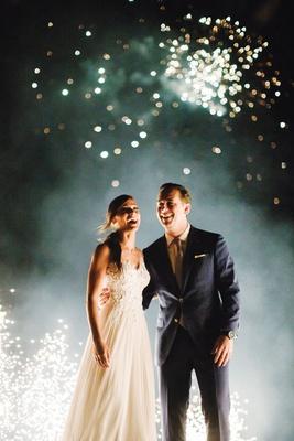wedding reception greece mykonos destination wedding firework show on beach dock