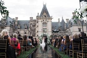 Wedding ceremony at the Biltmore Estate in Asheville, North Carolina black aisle runner gold crest