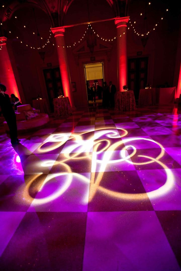 Wedding reception violet lighting with initial projected on floor