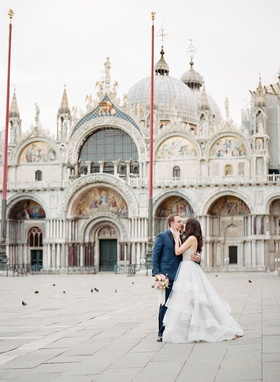 Destination wedding elopement portrait photo in St. Mark's Square in Venice, Italy