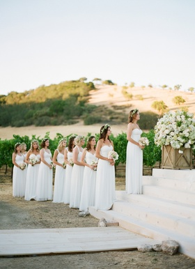 Bridesmaids at ceremony wearing flower crowns