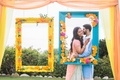 mehndi in orange county, south asian couple, photo booth inspiration, bright frames with flowers