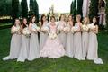 Bride in pink ruffle Mark Zunino wedding dress bridesmaids in high neck ruffle grey bridesmaid dress
