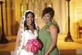Bride with mother of the bride in sage green gown