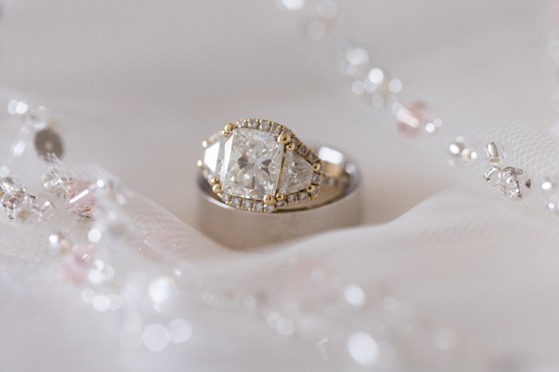 radiant diamond with trapezoid side stones, yellow gold pavé halo around all three