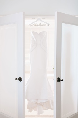 Wedding dress fluted bridal gown oscar de la renta wedding hanger french doors bridal suite