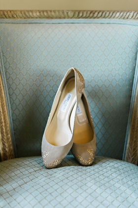 Jimmy Choo nude flats bridal wedding shoes with gold details on toe and heel