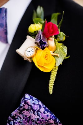alice in wonderland inspired boutonniere with yellow rose, wooden spool gold teapot clock