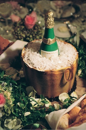 Cake designed to look like champagne bottle in ice bucket