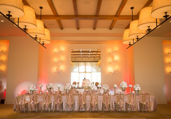 Long rectangular reception table with pink and white flowers