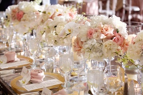 Wedding reception table with pink and white orchid, rose, peony, hydrangea