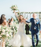 wedding ceremony exit bride groom recessional hands in air bouquet flowers muted color palette