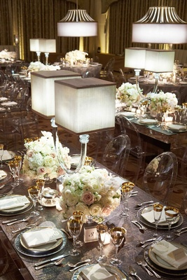 Mirror table clear ghost chairs white blush flower centerpiece lamp and grey crocodile leather mat