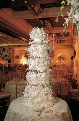 Towering Sylvia Weinstock wedding cake with hundreds of edible flowers