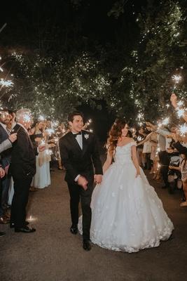 Echosmith singer Sydney Sierota and Cameron Quiseng wedding reception outdoor grand exit sparklers