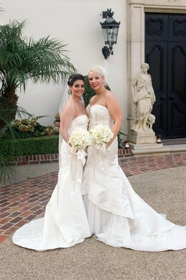 Lesbian couple hold matching calla lily bouquets