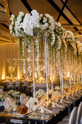 wedding reception tall silver riser white rose orchid flowers amaranthus glass orb candlelight tulip