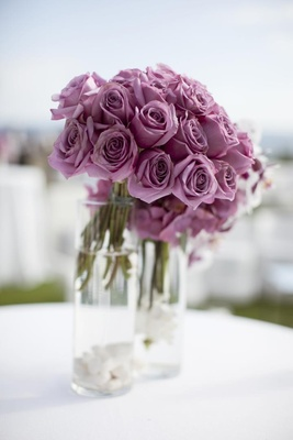 Purple-pink roses in clear glass vases