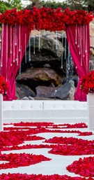 Outdoor wedding with lake and rocks in background