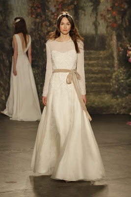 """crew neck, a-line """"viola"""" gown with sheer long sleeves and belt by jenny packham"""