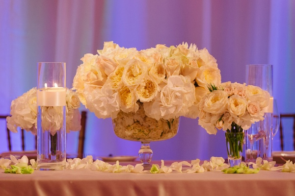 vase filled with petals, centerpiece of roses, hydrangeas, mums, and chrysanthemums