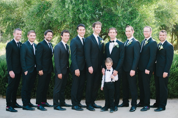 groomsmen in mismatched black suits, groom in tiger in sweden black suit