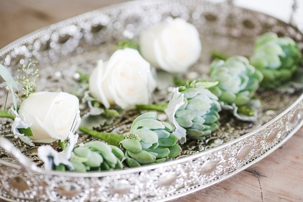 white rose boutonniere and succulent boutonnieres at destination wedding