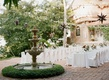 Wedding rehearsal dinner welcome party destination in Mexico tables by fountain and star lanterns