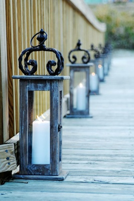 Distressed wood and iron lantern with pillar candle