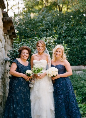 Katherine Kallinis with sister and mother in navy dresses