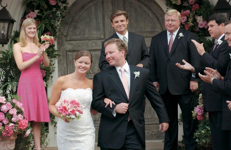 Bride and groom exit wedding as newlyweds