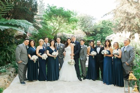 Bride and groom with navy bridesmaid dresses and grey suits for groomsmen Hotel Bel-Air
