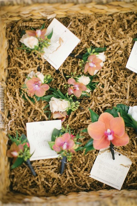 orchid pink boutonniere for groom fathers groomsmen in basket