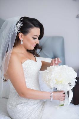 Armenian bride with flower headpiece, bracelet, white peony bouquet with ribbon, teardrop earrings