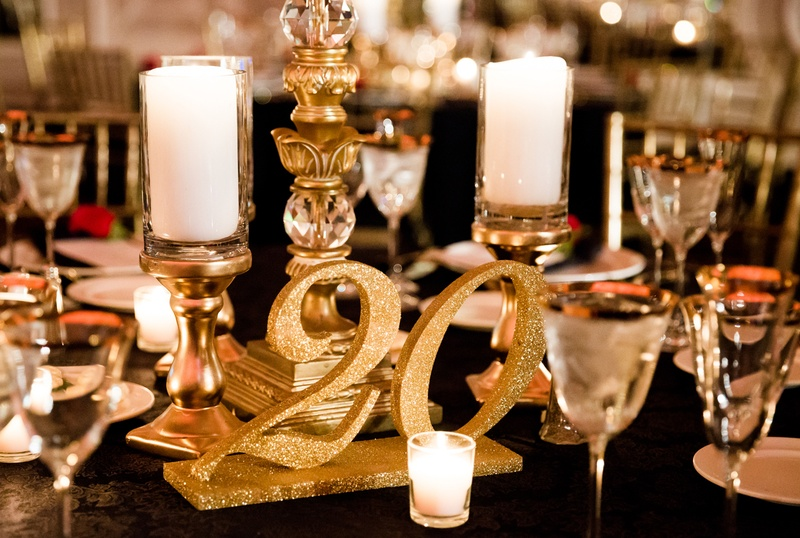 glitter gold table numbers, pillar candles on gold stands