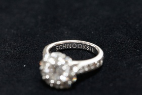 Bride's diamond engagement ring with round center stone, halo, inscription