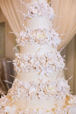 Wedding cake opulent new year's eve wedding ivory fondant layers and sugar flowers on each tier