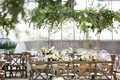 industrial chairs and vineyard x back chairs around wood table greenery low centerpiece greenhouse
