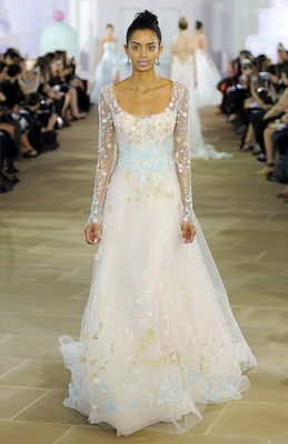 Multi-colored embroidered soft tulle ball gown with scooped neckline and illusion sleeve.