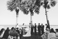 black and white photo of grass aisle wedding ceremony overlooking ocean palm trees island wedding