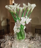 centerpiece of tall white calla lilies wrapped with white orchids