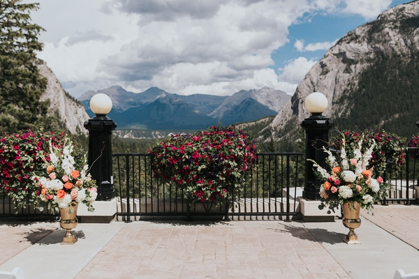 Banff wedding, mountain views, white and magenta gladiolus, peach roses
