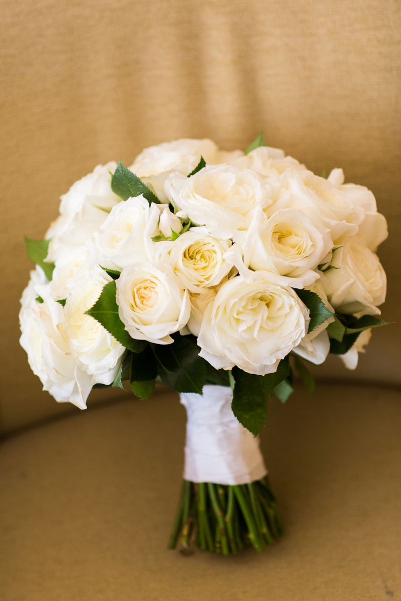 White rose ivory rose flowers wrapped with white ribbon green stems exposed